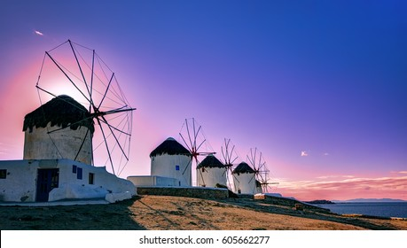 Traditional windmills, the symbol of Mykonos at sunset, Greece