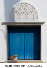 Traditional window with cat at Pyrgos (Panormos) village in Tinos island, Greece