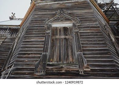 Traditional window frames on the wooden wall of a village house. Old architecture. Boarded up doorway