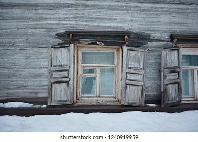 Traditional window frames on the wooden wall of a village house. Old architecture