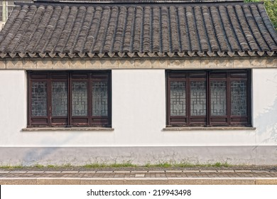 The traditional window, roof and concrete wall of antique Chinese building in China