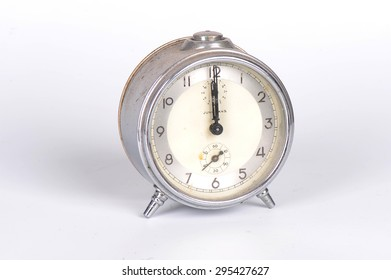Traditional wind-up, mechanical, spring-driven alarm clock