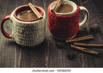 Traditional winter eggnog in decorative mugs with cinnamon/Traditional winter eggnog in decorative mugs with cinnamon on a dark background