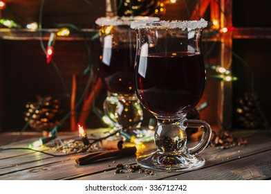 Traditional winter mulled wine and christmas ornament, selective focus