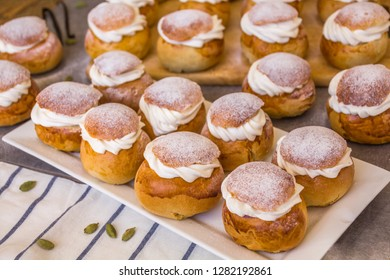 Traditional winter sweet: Semla or semlor, flavored with cardamom, filled with almond paste & whipped cream from Sweden, Finland, Estonia, Norway & Denmark for Shrove Monday, fat Tuesday & Easter