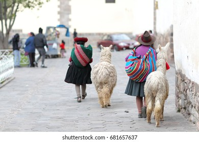Traditional women with llamas from Cusco, Peru
