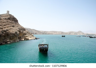 Traditional wooden boat parks in the sea