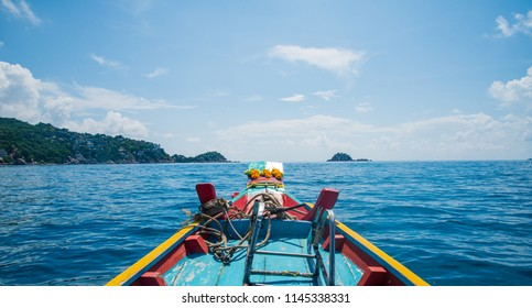 Traditional wooden boat in a picture perfect tropical Sky with clouds and ocean at koh tao island,Thailand ,Asia
