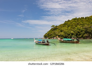 Traditional wooden boats on a beautiful tropical beach.
