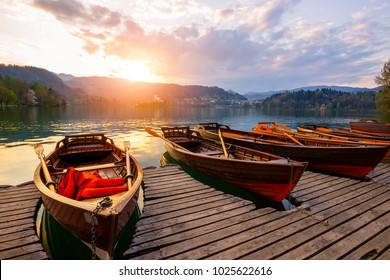 Traditional wooden boats Pletna on the backgorund of Church on the Island on Lake Bled, Slovenia.  Europe.