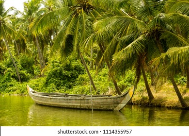 Traditional wooden canoe on the shores of Kannur backwaters, Kerala, India.