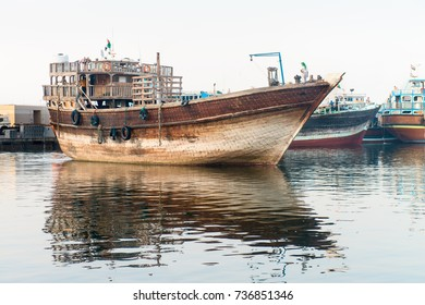 Traditional wooden cargo ship in Dubai dhow port