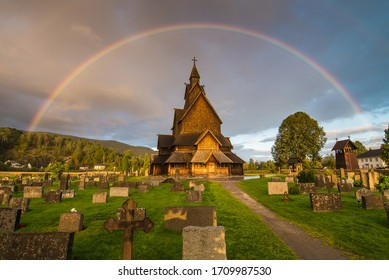 traditional wooden church with rainbow, Norway, Europe.