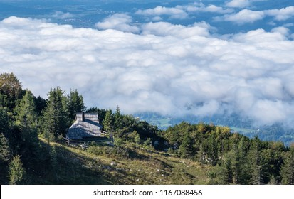 Traditional wooden cottage on Velika planina (Big Pasture Plateau) high over the clouds, Slovenia