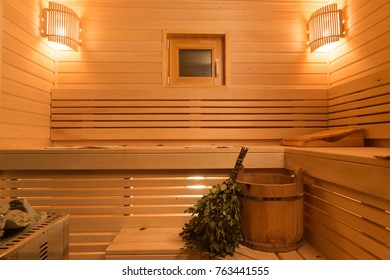 Traditional wooden design of sauna. Light and heat in small cozy room.