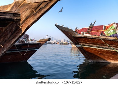 Traditional wooden dhow cruise across the Creek with a view of skyline of Dubai, United Arab Emirates