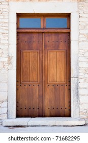 Traditional wooden doors in old house made of stones