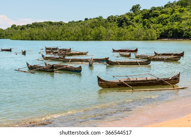 Traditional wooden dugout rowing outrigger canoes on Nosy Be island