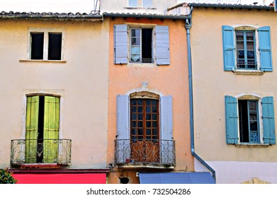 traditional wooden facade facade with wooden windows in the historic center of Nîmes in France