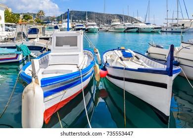 Traditional wooden fishing boats docked at Moraira port, Costa Blanca, Spain