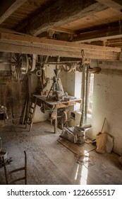 Traditional wooden flour mill equipment, viewed from side and other mill pully equipment, beamed celings very visible