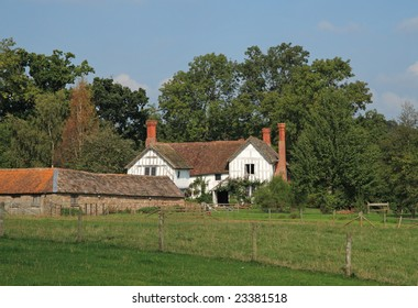 Traditional Wooden Framed English Rural House and garden