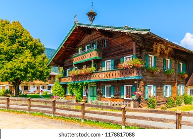 Traditional wooden house decorated with flowers in Reith bei Kitzbuhel village, Tirol, Austria