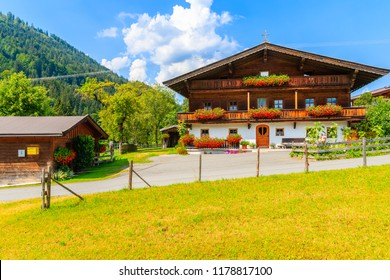 Traditional wooden house decorated with flowers in small village near Kitzbuhel, Tirol, Austria