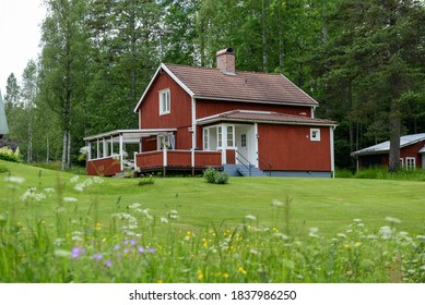 Traditional wooden house on concrete foundation in Sweden