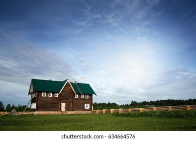 Traditional wooden house at sunny day in the countryside.