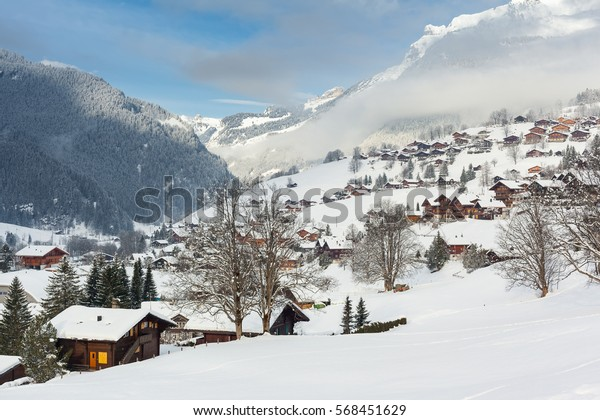 Traditional wooden houses on the mountainside in Grindelwald, Switzerland.