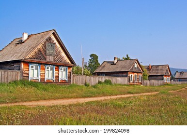 traditional wooden houses in a remote village in Russian Siberia at the shores of Lake Baikal