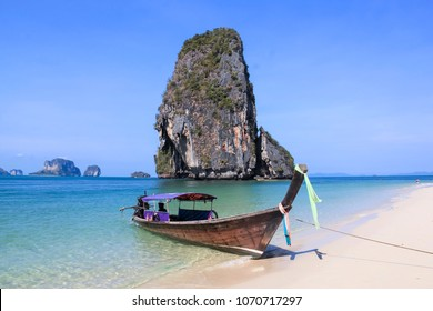 Traditional Wooden Longtail Boat anchored on Railay Beach in Krabi Province Southern Thailand, Longtail Boats are used as water taxis between the beaches and islands of krabi a popular tourism destina