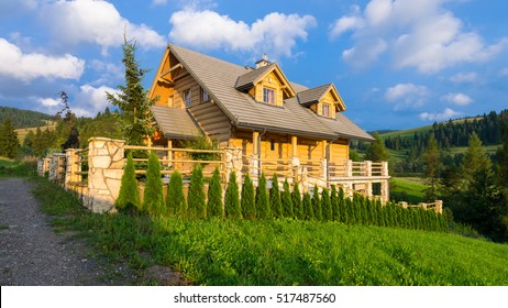 Traditional wooden mountain house built from wood logs on summer sunny day, Pieniny Mountains, Jaworki, Poland - typical farmhouse for this mountainous region
