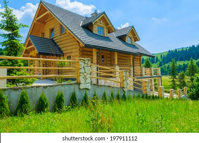 Traditional wooden mountain house on green field in summer, Szczawnica, Beskid Mountains, Poland