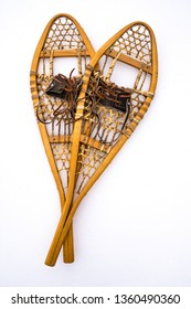 Traditional Wooden, Rawhide and Leather Snowshoes, Child's Size, Isolated on Bright White Snow. Background Image. Concept Image. Centre/Center Darker.