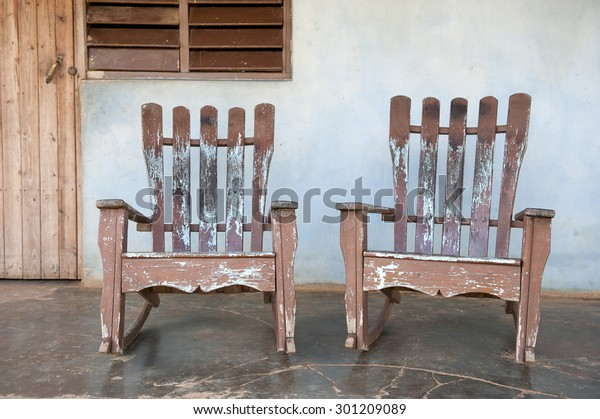 Super Traditional Wooden Rocking Chairs On Rustic Stock Photo Ibusinesslaw Wood Chair Design Ideas Ibusinesslaworg