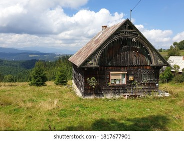Traditional wooden romanian house in Marisel, Cluj County, Transylvania, Romania. Wooden village building architecture in rural area in Apuseni mountains