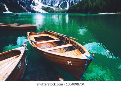 Traditional wooden rowing boats on italian alpine Braies Lake at summer. Lago Di Braies is largest natural lake in Dolomites, South Tyrol, Italy, Europe.