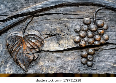 Traditional wooden sculpture engravement on a gate in Moldova with grapes and vine symbols