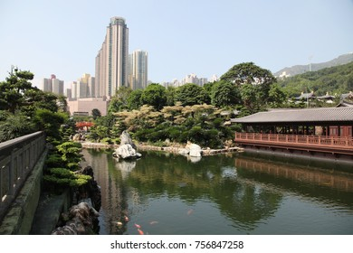 Traditional wooden tea house and pond with goldfish in Nan Lian garden in Hong Kong
