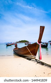 Traditional wooden thai boat on the beach, Thailand.