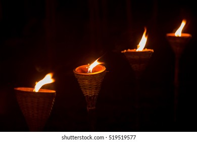 Traditional wooden torch flame at night