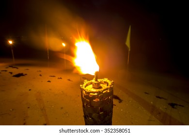 Traditional wooden torch flame on night background