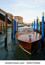 Traditional wooden Venetian water taxi parked at The Grand Canal. Venice, Italy