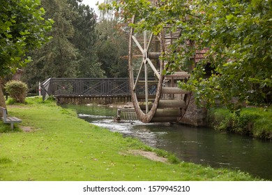 Traditional wooden waterwheel on a small river