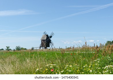 Traditional wooden windmill, the symbol of the island of sun and wind Oland in the Baltic Sea in Sweden