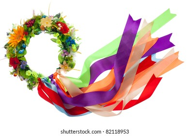 Traditional wreath with flowers and many-colored satin ribbons as a symbol of National Ukrainian folk costume isolated