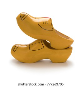 Traditional yellow Dutch wooden shoes on white background