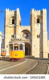 Traditional yellow trams on a street in Lisbon, Portugal